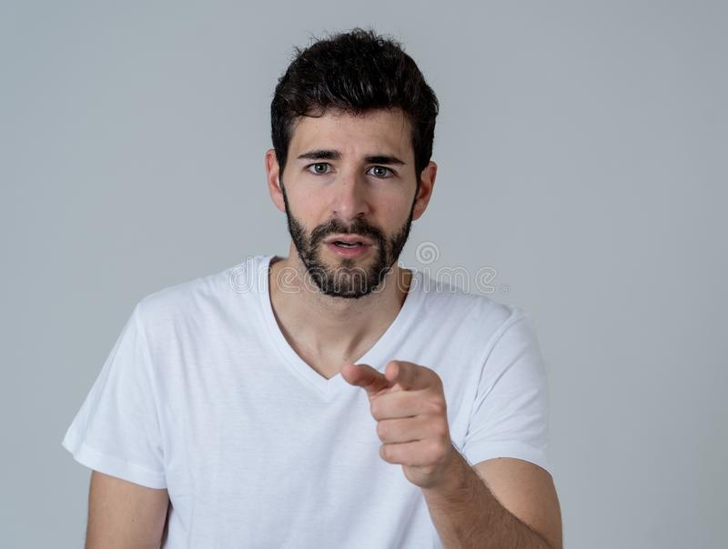 Close up portrait of attractive man surprised celebrating victory goal wining team or lottery. Portrait of Amazed excited funny Man achieving his goal or wining stock photos