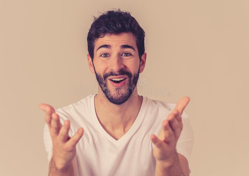 Close up portrait of attractive man surprised celebrating victory goal wining team or lottery. Portrait of Amazed excited funny Man achieving his goal or wining royalty free stock photo