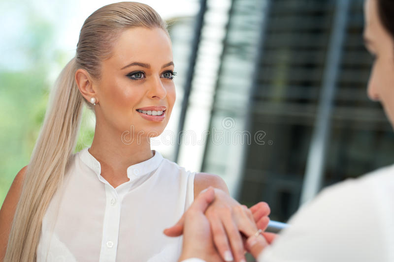 Young man proposing to attractive woman. Close up portrait of attractive women on proposal date royalty free stock image