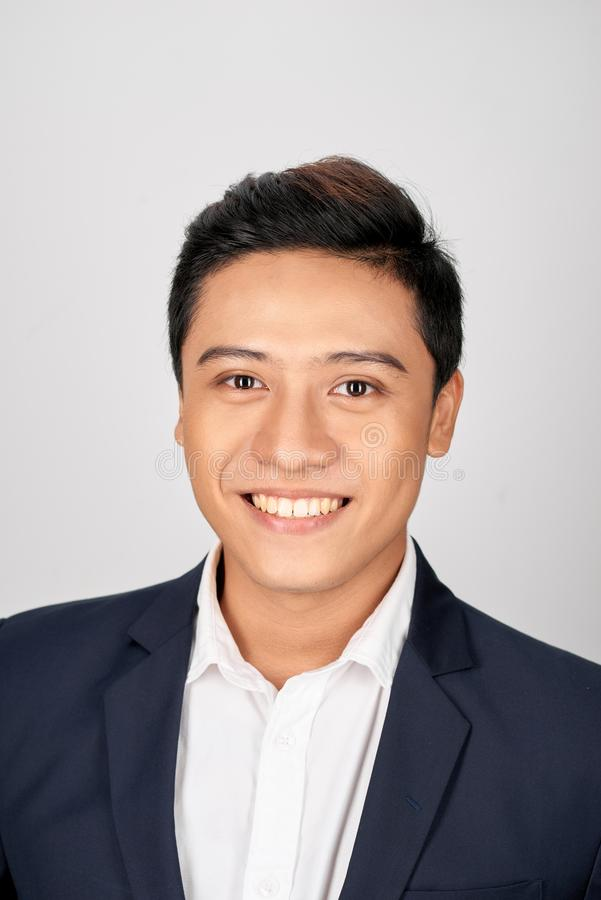 Close up portrait of an attractive young businessman smiling royalty free stock images