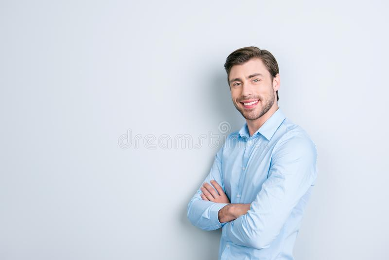 Close up portrait of attractive young entrepreneur with arms fol royalty free stock photo
