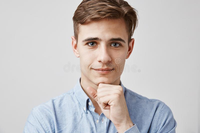 Close up portrait of attractive young guy. Please, talk, I am listening. Handsome young man hears problems of his royalty free stock photos