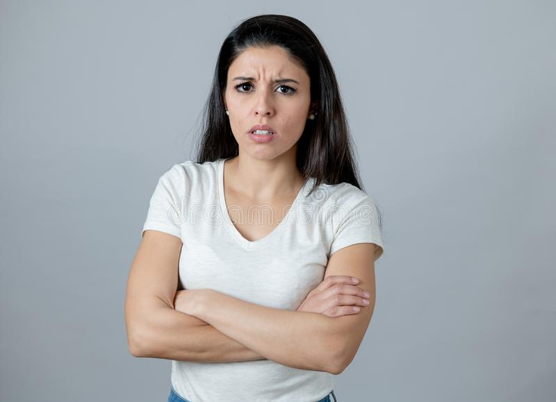Human expressions and emotions. Young attractive woman with an angry face, looking furious and upset. Close up portrait of an attractive young latin woman with royalty free stock photos