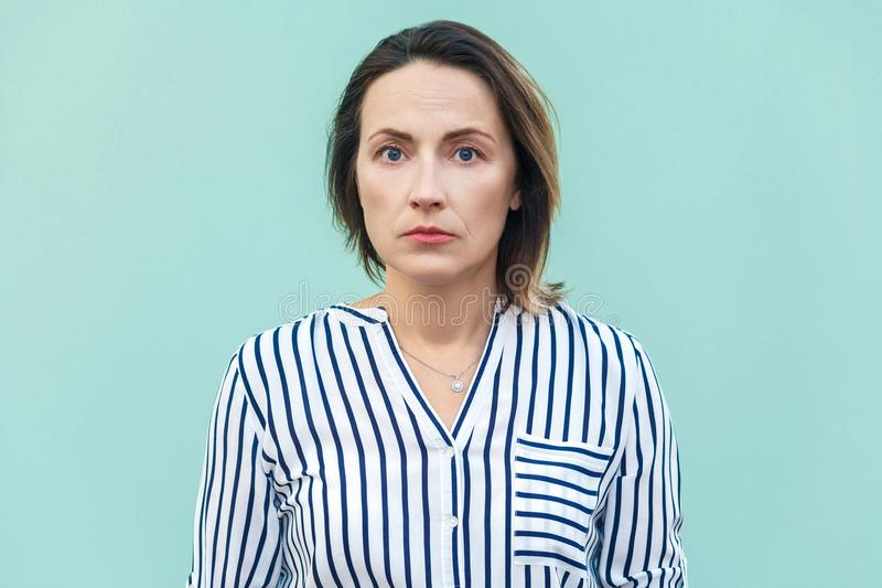Close up, portrait bad mood business woman. Unhappy business woman looking at camera with tired face. stock photos