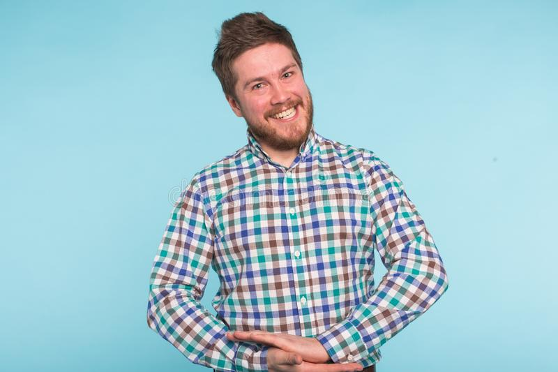 Close-up portrait of bearded handsome man on blue background stock photography