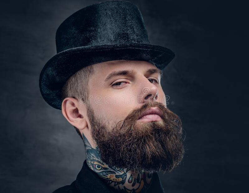 Close up portrait of bearded male with tattooed neck. stock image