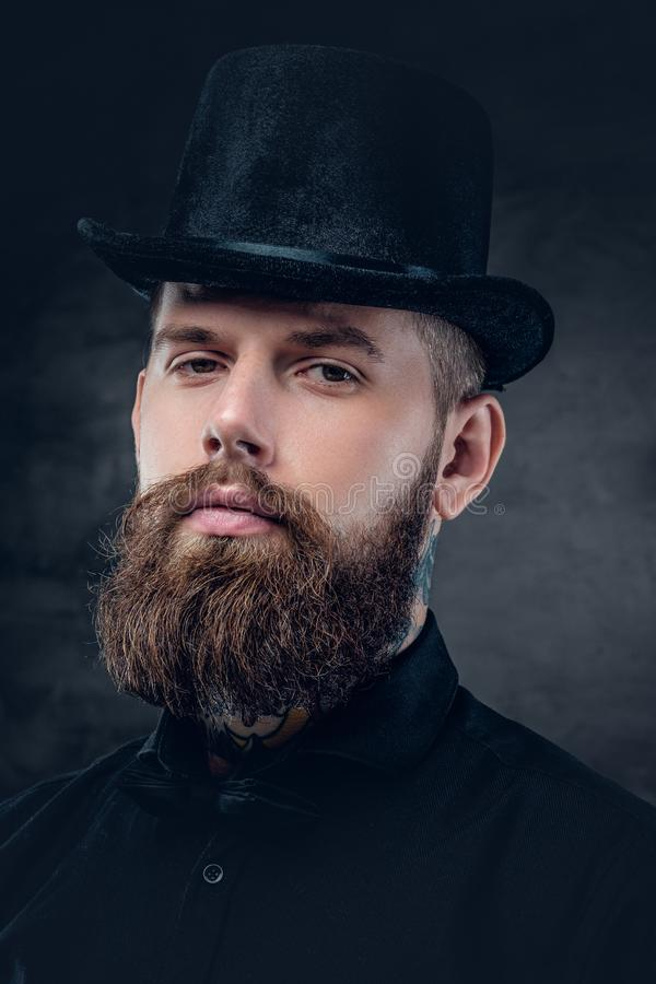 Close up portrait of bearded male with tattooed neck. stock photos