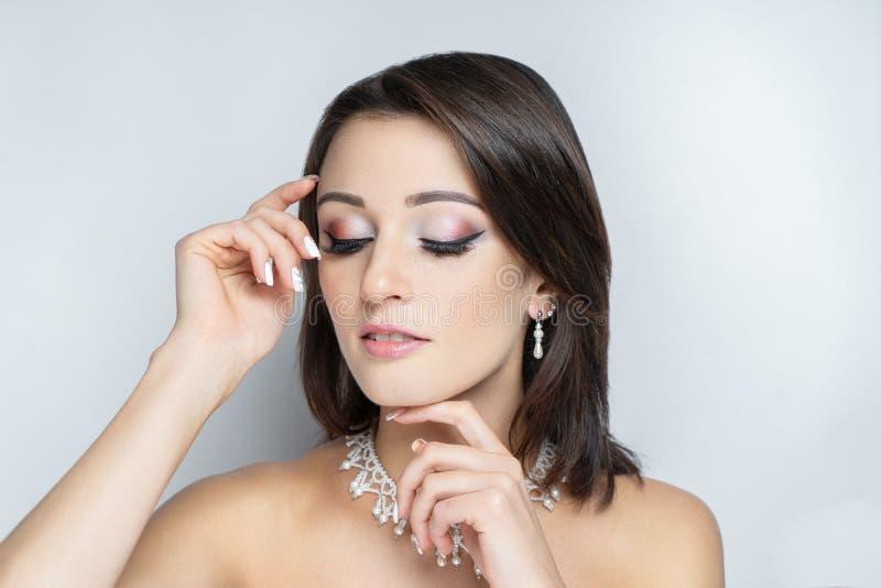 Beauty woman glossy lipstick, nude tone cream royalty free stock photos