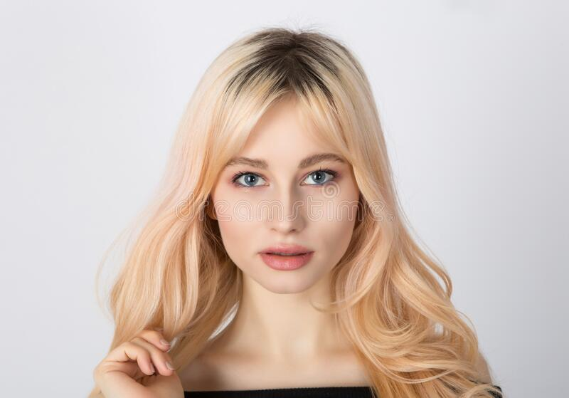 Close up portrait of a beautiful blonde girl with nice face royalty free stock images