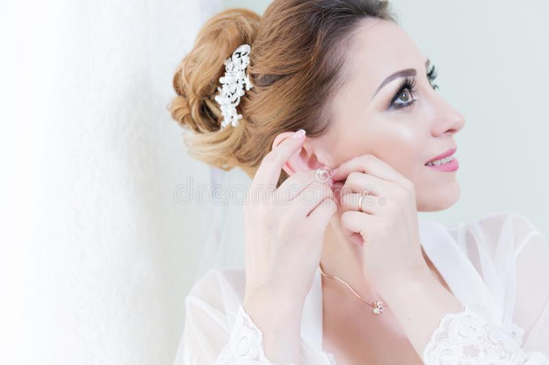 Close-up portrait of a beautiful bride in the morning during a wedding ceremony. royalty free stock images