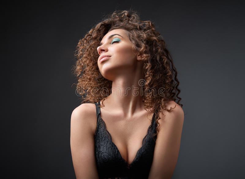 Portrait of a beautiful female fashion model with curly hair royalty free stock photo