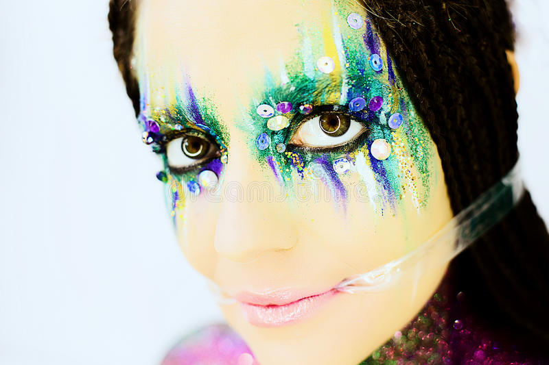 Close up portrait of a beautiful girl with creative glitter make up royalty free stock photos