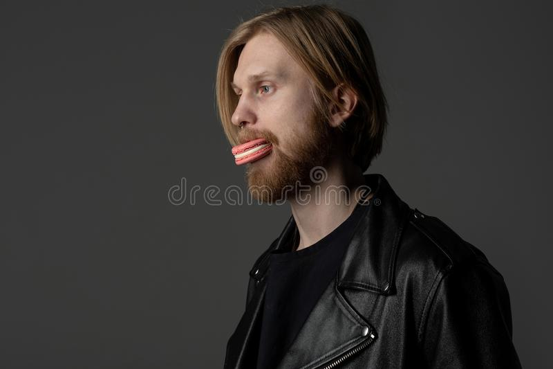Close up portrait of beautiful guy with light hair and beard royalty free stock photos
