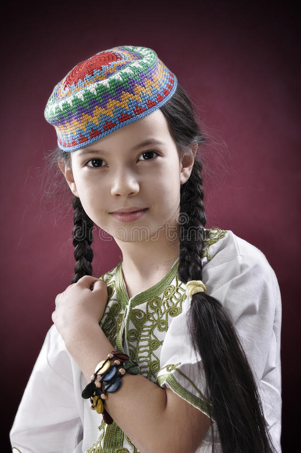 Close-up portrait of beautiful little girl. In national arabic wear stock image