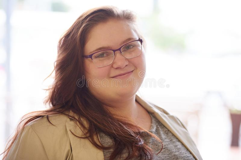 Close up portrait of beautiful plus size young adult woman royalty free stock image