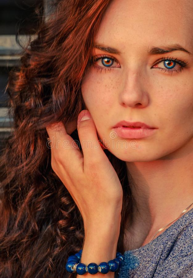 Close up portrait of a beautiful red haired girl. Amazing model looking at camera. Warm art colorized stock image