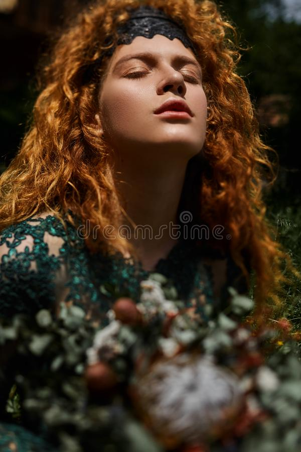 Close up portrait of a beautiful redhead girl playing with hair royalty free stock photos