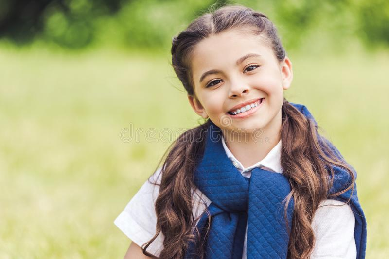 close-up portrait of beautiful schoolgirl in stylish clothes stock photo