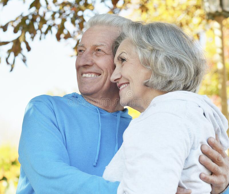Portrait of beautiful senior couple in the park royalty free stock images