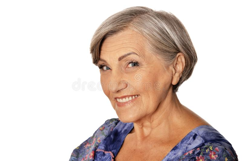 Close up portrait of beautiful senior woman posing isolated on white background royalty free stock photography