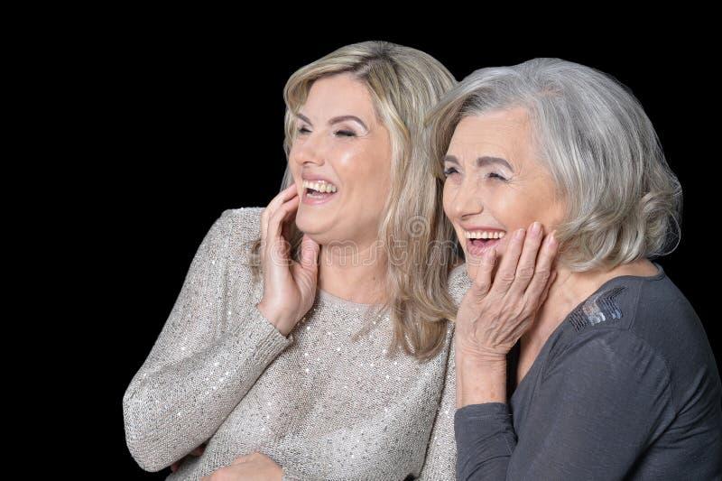 Close up portrait of beautiful senior women isolated stock photo