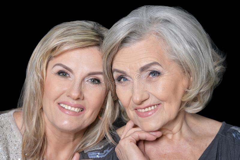 Close up portrait of beautiful senior women isolated stock photos