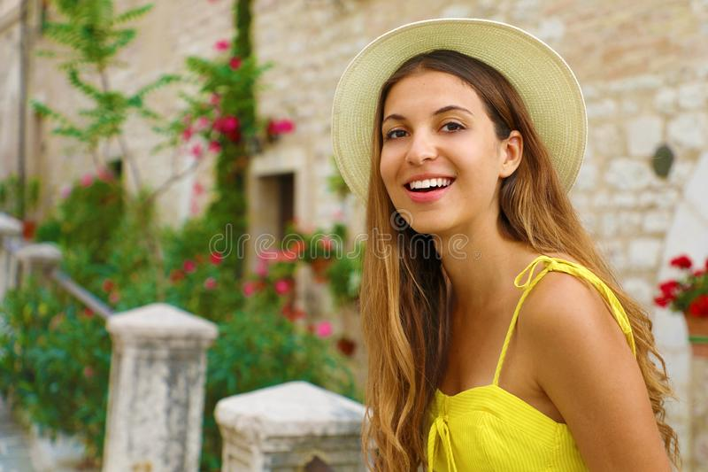 Close up portrait of a beautiful smiling girl with long hair wearing a hat and looking at camera outdoors stock photos
