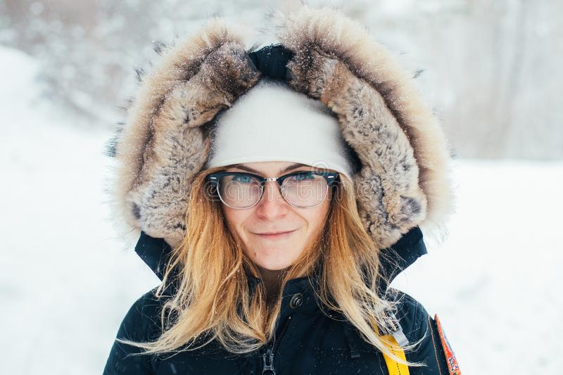 Portrait of young woman in cold deep winter coat stock photos