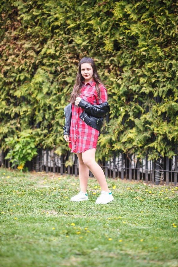Close up portrait of beautiful stylish plus size model kid girl in plaid shirt and leather jacket.  stock image
