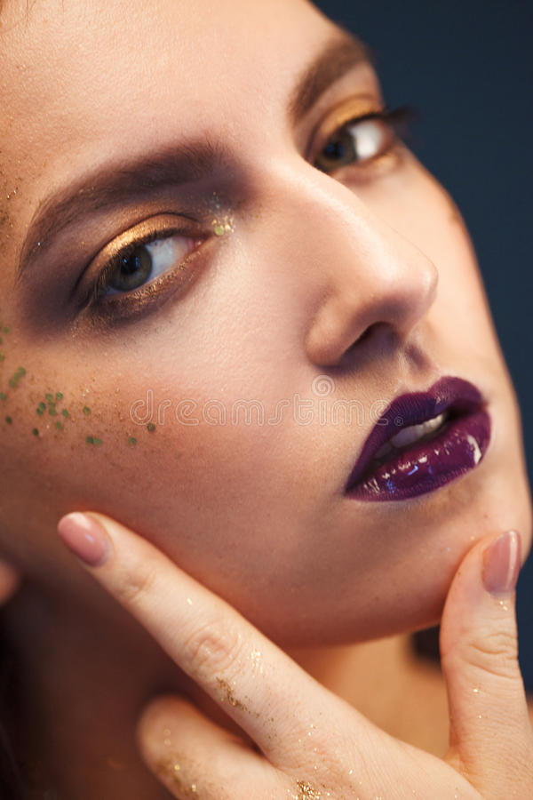 Close up portrait of beautiful woman with creative gold make up. Close up portrait of beautiful woman with gold make up stock photos