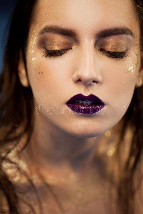 Close up portrait of beautiful woman with creative gold make up. Close up portrait of beautiful woman with gold make up royalty free stock image