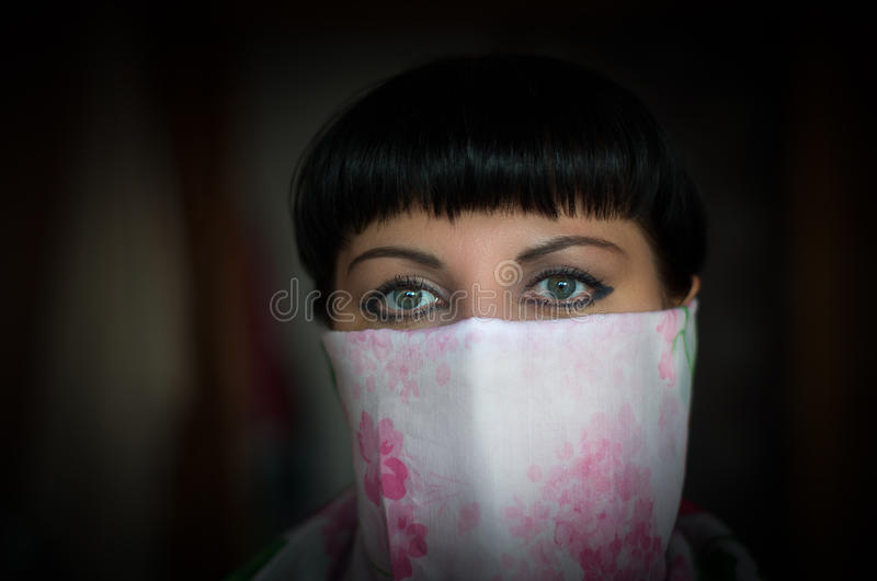 Close-up portrait of a beautiful woman with expressive green eye royalty free stock image