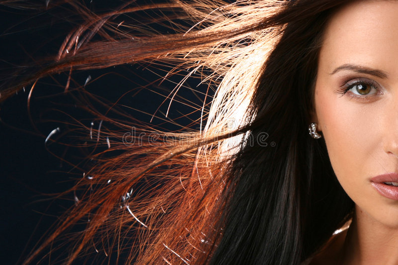Close-up portrait of beautiful woman half face royalty free stock photography