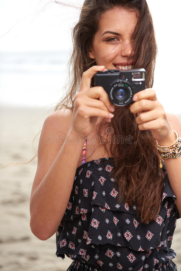 Close up Portrait of beautiful woman with retro hipster camera stock image
