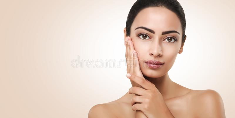Beautiful indian girl with perfect skin touching face royalty free stock photos