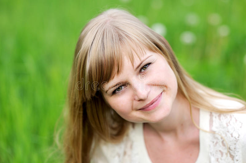 Close-up portrait of beautiful young blond woman stock images