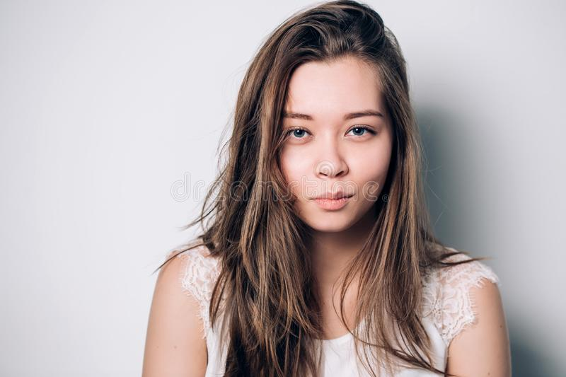 Close up portrait of the beautiful young sly woman stock photo