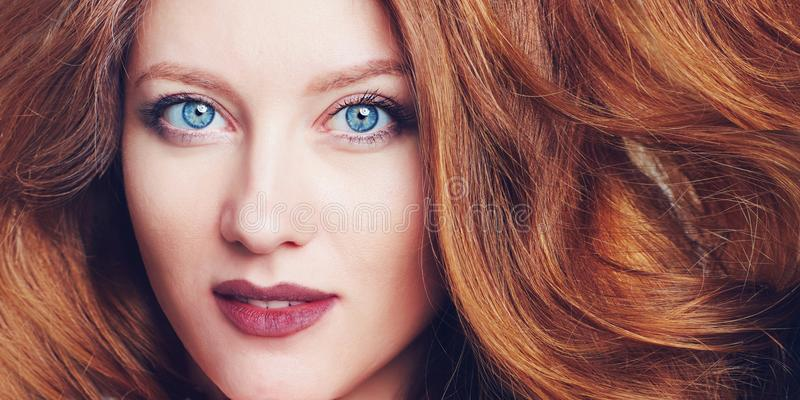 Portrait of beautiful young woman with big blue eyes, berry lips and brazen hair stock photography