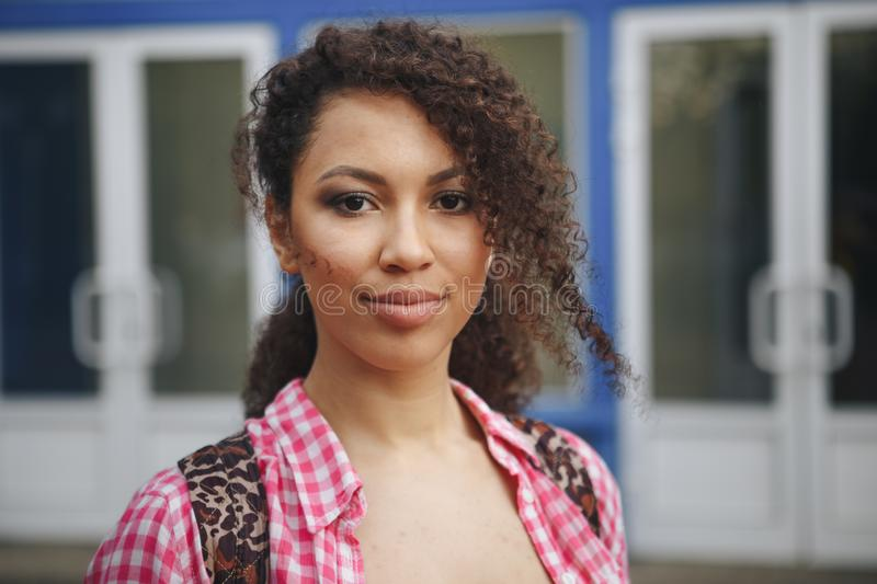 Close up portrait of a beautiful young woman with curly hair stock photos