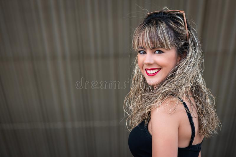 Close up portrait of a beautiful young woman with curly hair royalty free stock image