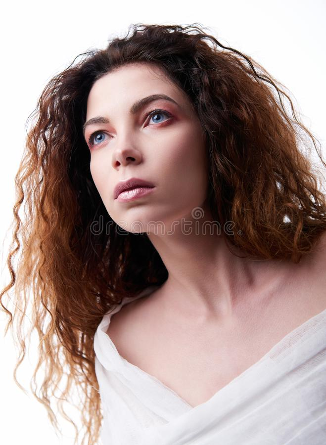 Close-up portrait of beautiful young woman with curly hair royalty free stock images