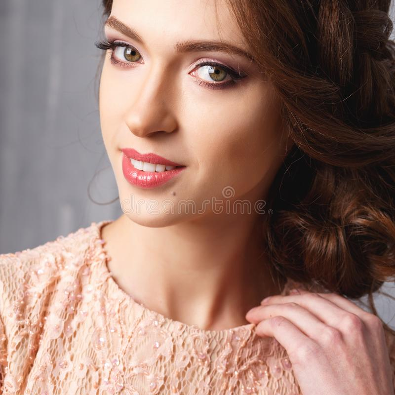 Close-up portrait of beautiful young woman in luxury dress, pastel color. Beauty fashion portrait royalty free stock photography