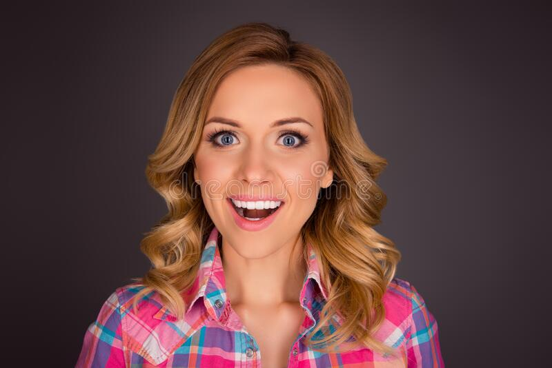Close up portrait of beautiful young woman pleasantly surprised royalty free stock photography