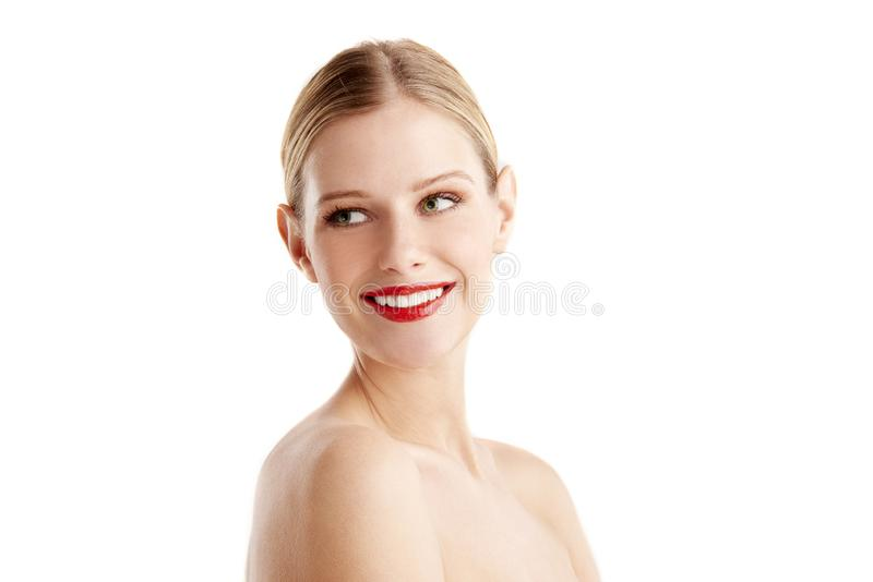 Close-up portrait of cheerful young woman with beautiful face posing at isolated white background stock photo