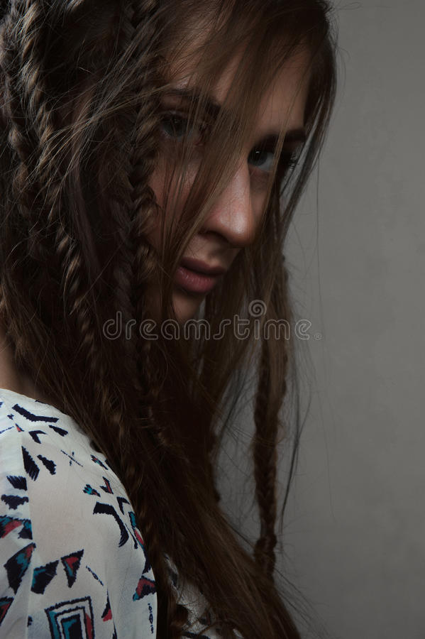 Close-up portrait of beauty horsewoman with braids and big eyes. Close-up portrait of beautiful horsewoman with braids and big eyes stock images