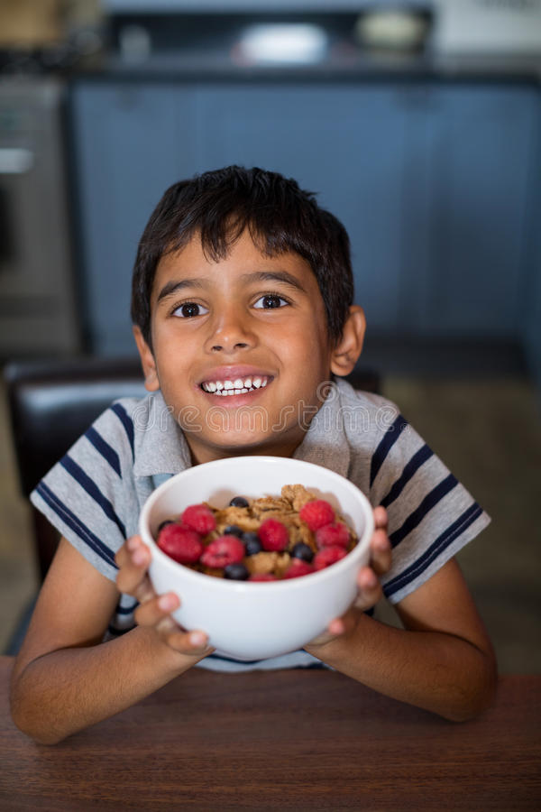 Close up portrait of boy showing cereal breakfast royalty free stock image