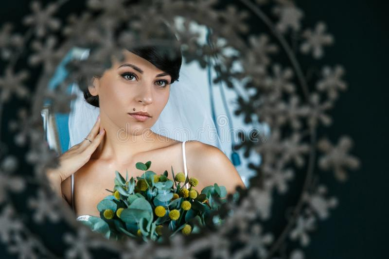 Close up portrait of the bride in the mirror royalty free stock photography
