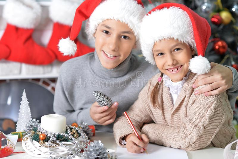 Close up portrait of brother and sister preparing for Christmas stock photos