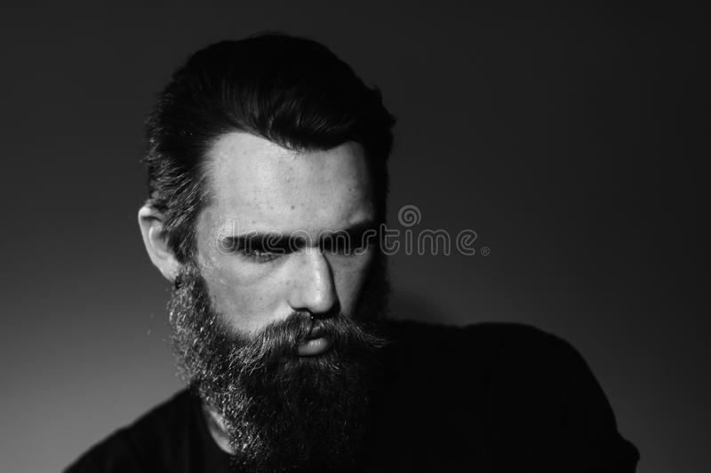 Close up. portrait of a brutal bearded man . stock photography