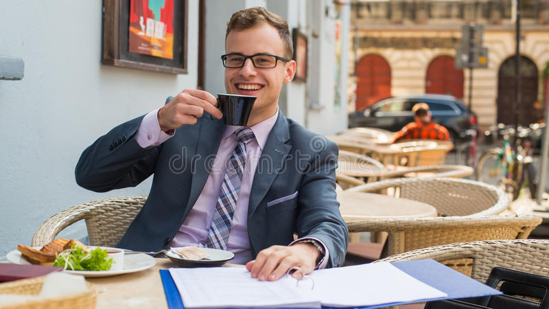 Download A Close-up Portrait Of A Businessman Having Breakfast. Stock Photo - Image: 34061740